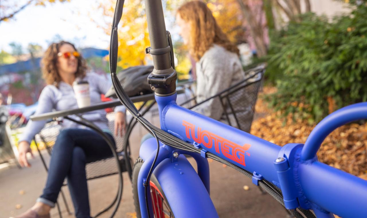 blue tuoteg bike with women talking in background