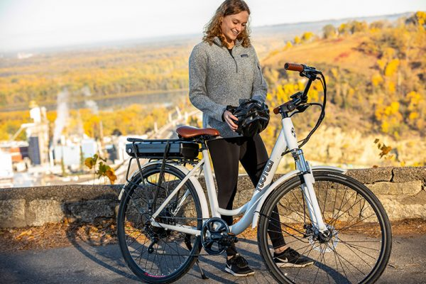 woman about to ride white bike