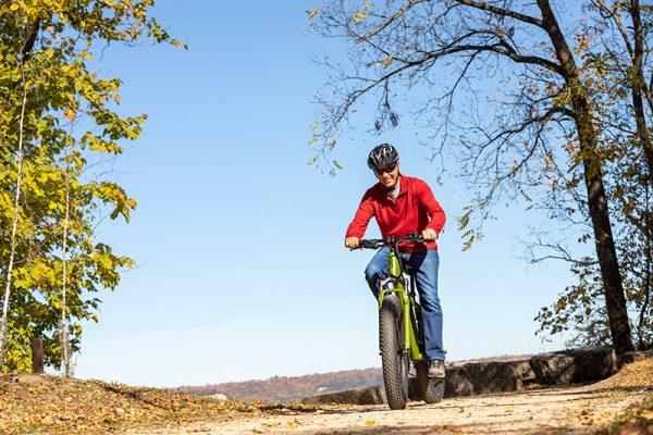 man riding bike on mountain trail