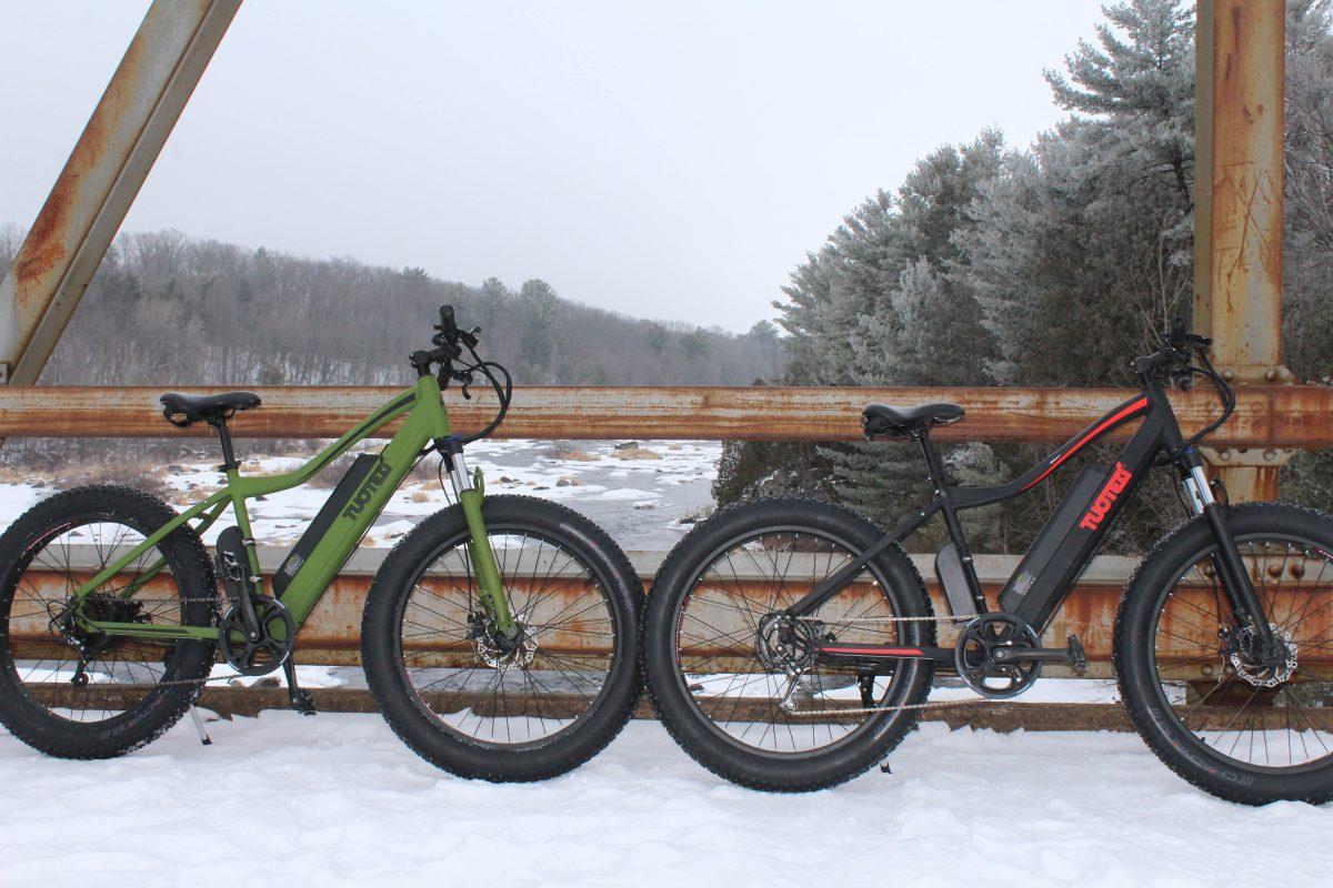 electric bikes on bridge in snow