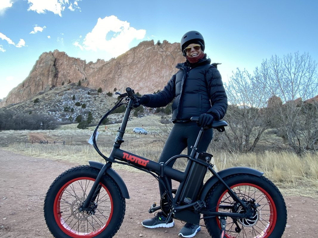 Woman Smiling Big With eBike In Front of Mountains