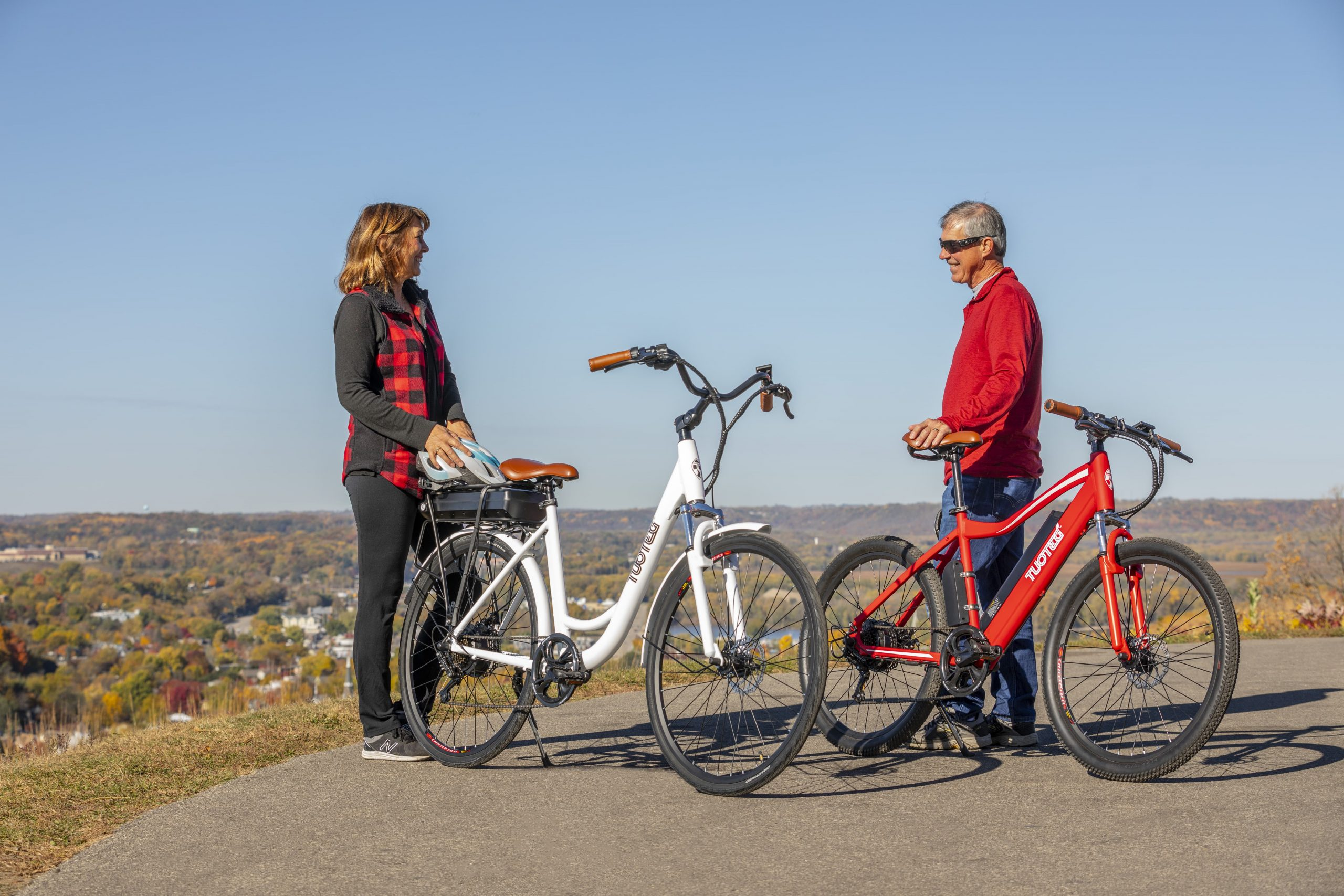 Man and Woman Talking By eBikes