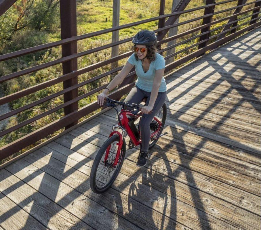 Woman Riding a Tuoteg XPLR Bike