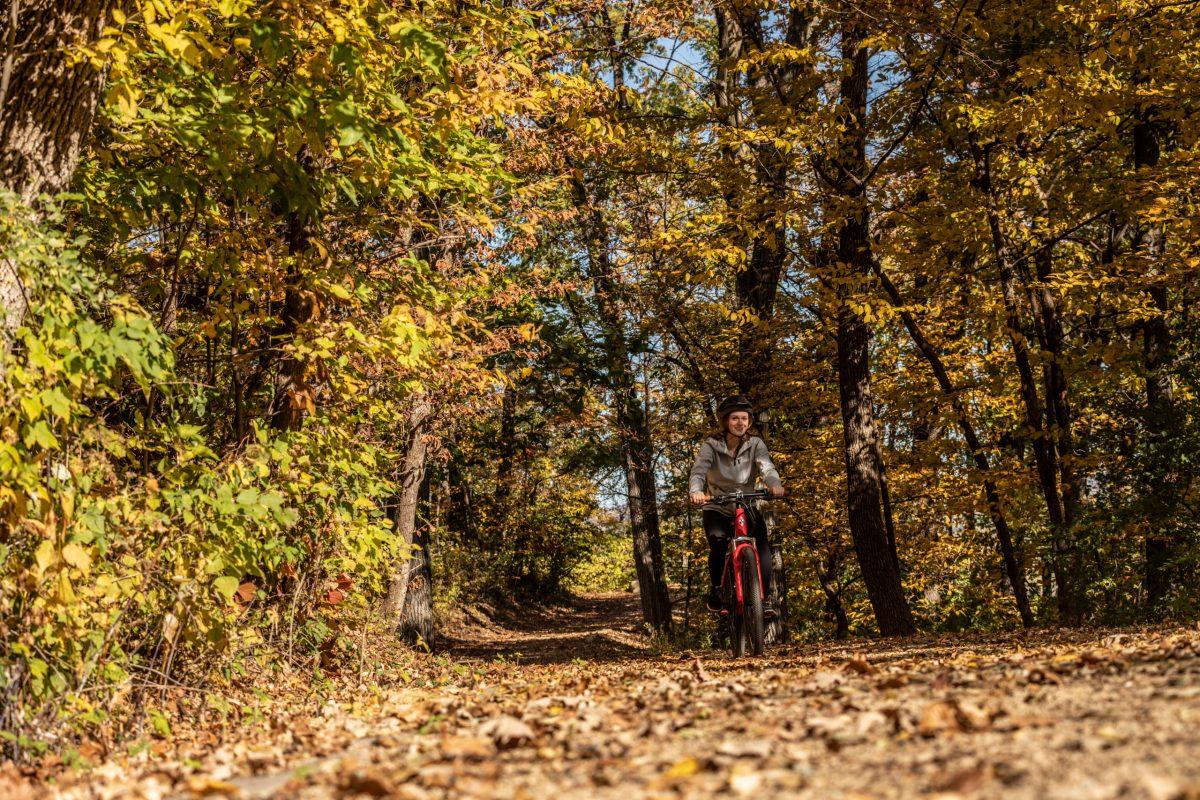 Woman Riding TUOTEG Bike