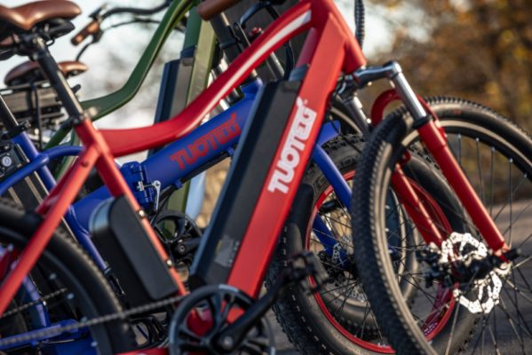 close up of red and blue Tuoteg ebiking Ebikes lined up